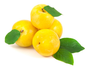 Yellow plums with leaves on white background