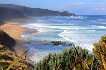 Australian coastal ocean surf beach with man fishing