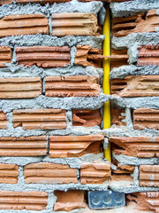 Brick and electric pipes