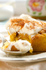 Homemade pumpkin cinnamon rolls with spices and sweet cream