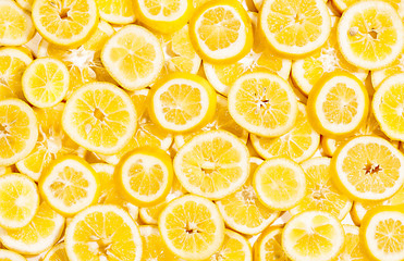 Full frame of bright yellow lemon slices shot from above
