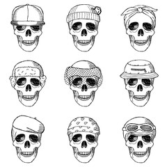 Set of hand drawn skulls with hats