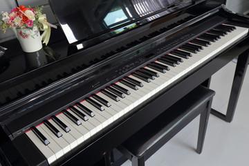 A black electronic piano