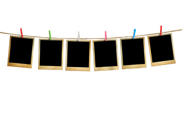 Old picture frame hanging on clothesline white background.