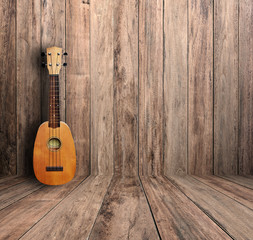 Ukulele in old room.