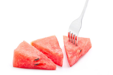 Pieces of watermelon with fork isolated on white background.