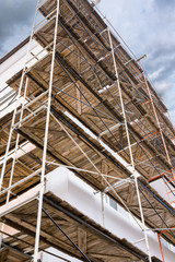old building facade under construction with scaffolding