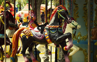 Old Carousel Horse closeup in the park