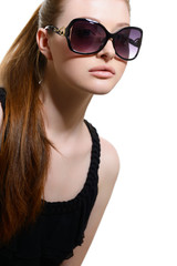 Beautiful young model with big sunglasses, close up.