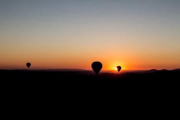 sunset and balloons in cappadocia