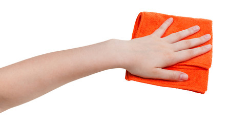 hand with orange dusting rag isolated on whit