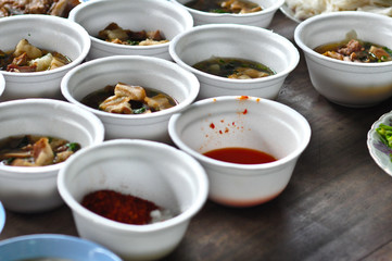 many type of food in foam bowl container on wood floor call kind