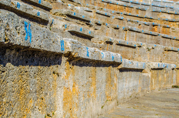 detail of stone seats with numbers of the ancient roman theatre in macedonian town ohrid, which belong to the unesco world heritage.
