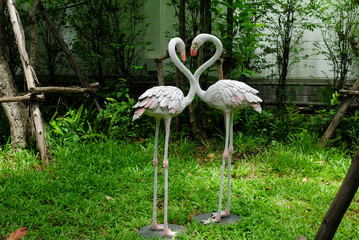 statue bird background garden two animal flamingo