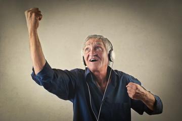 Elderly man listening to music
