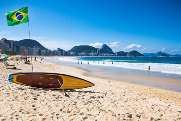 Brazilian flag and surfboard  at Copacabana Beach, Rio de Janeir