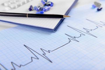 Stethoscope on cardiogram  sheet, closeup
