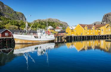Fishing boat moored in the fishing port. Lofoten arcghipelago.