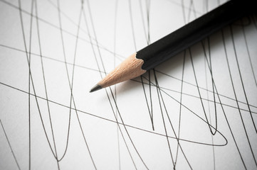 Pencil with black curved lines.