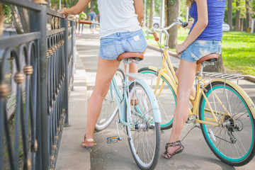 beautiful sexy women dressed in short shorts travel by bicycle