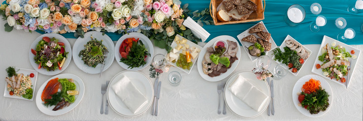 Table set and salad for a wedding reception top view