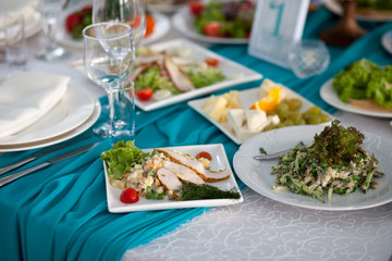 Table set and salad for a wedding reception