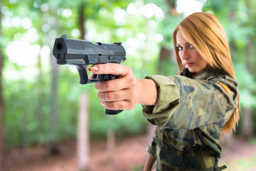 military woman shooting a gun