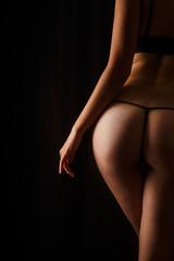 Sexy butt girls in underwear over black background