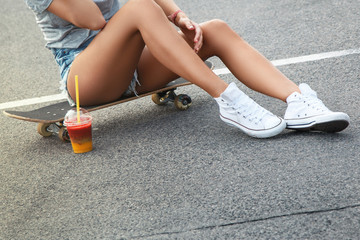 Skateboard, sexy legs and smoothie drink