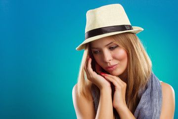 Portrait of beautiful woman with straw hat.