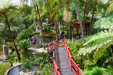 Monte Palace Tropical Garden. Red bridges in oriental garden. Funchal, Madeira Island, Portugal