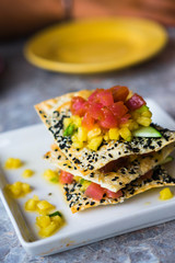 Appetizer with chips,tuna fish and fruits