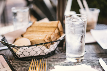 Bread and water on the table outdoors