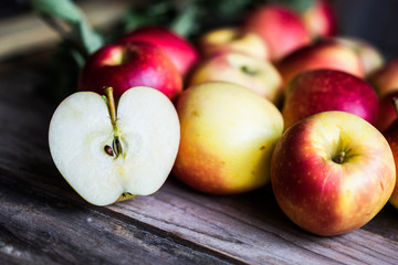 Apples on rustic wooden background