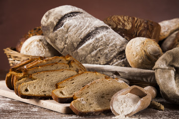 Freshly baked traditional bread on wooden table
