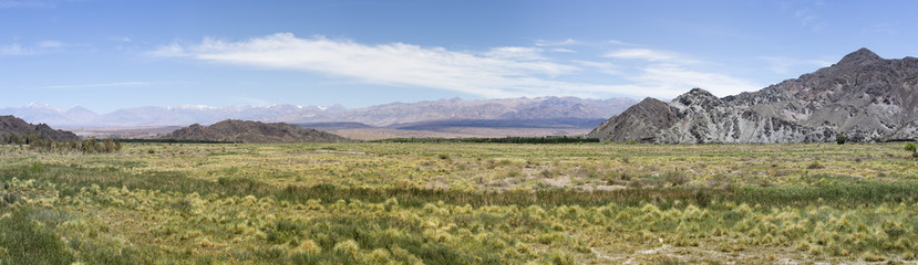 Panorama of mountains, arid wild landscape and blue sky on the famous Ruta 40 (Route 40), within Calchaqui Valleys in Salta Province. Argentina