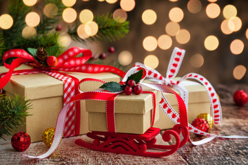 Christmas presents  and festive decor over wooden background