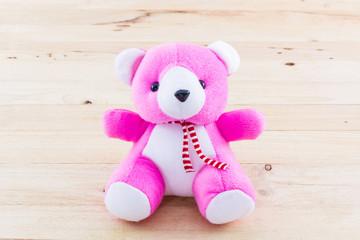 Pink teddy bear toy.