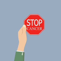 hand holds Stop cancer sign