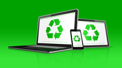Laptop tablet PC and smartphone with a recycle symbol on screen.