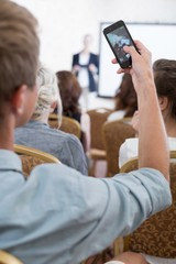 Student taking photo during conference