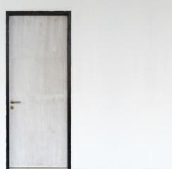 wood door with concrete wall