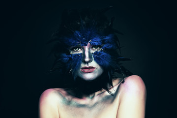 Carnival costume. Woman with Fantasy Makeup. Blue Bird Mask