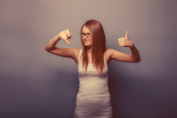 European-looking girl of twenty years thumbs up, thumbs down on