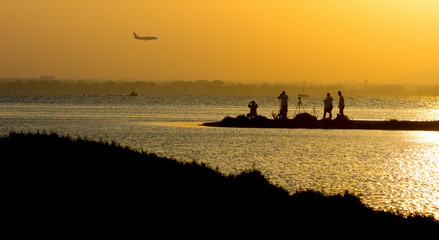 people photography planes by the sea at sunset