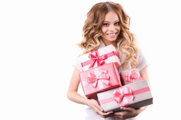 Smiling woman with curly hair holding gifts Isolated on white background.