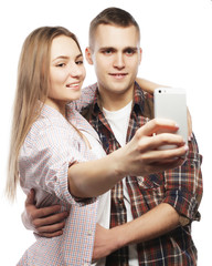 smiling couple with smartphone, selfie and fun.