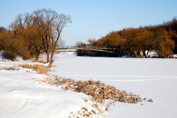 iron bridge over the frozen river