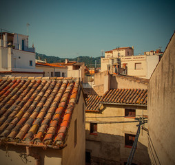 Tossa de Mar, Catalonia, Spain, 06.17.2013, roofs of houses in t