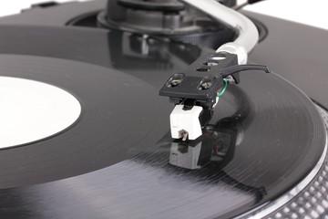 Dj needle on spinning turntable
